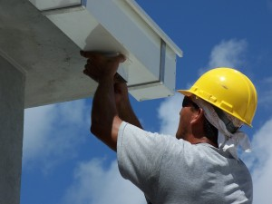 Commercial roofing gutter installation.